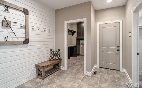 Modern Brown and White Entry Way